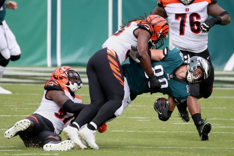 Cincinnati Bengals linebackers Germaine Pratt (57) and Josh Bynes (56) bring down Dallas Goedert on the play in which the Eagles tight end was injured.