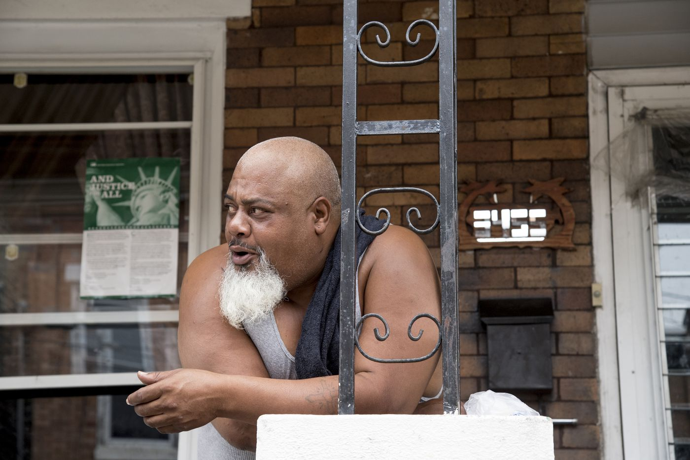 Juan Camargo on his home's front porch in the Fairhill neighborhood.