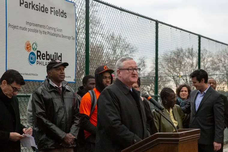 Nicole Westerman, third from right, watched Mayor Jim Kenney speak at the groundbreaking ceremony of the first Rebuild project at Parkside Fields in December. Westerman resigned Friday as executive director of Rebuild.