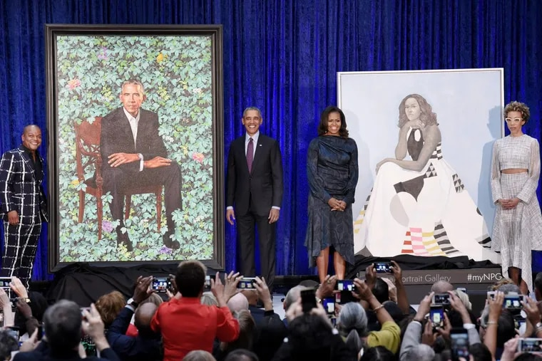 Former first lady Michelle Obama and former President Barack Obama pose with artists Kehinde Wiley and Amy Sherald during the unveiling of their official portraits at the National Portrait Gallery on Monday, February 12, 2018, in Washington, D.C.