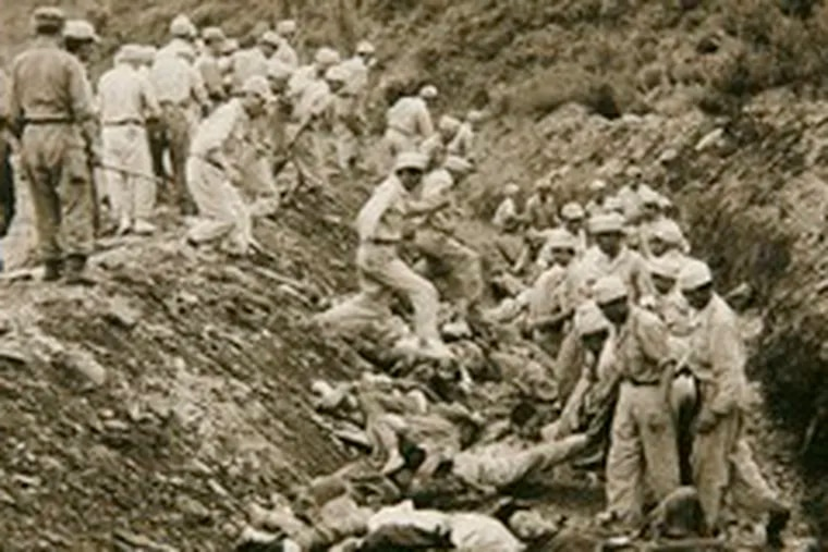 Mass graves like this one have been discovered in recent years, leading to an investigative panel that aims to find the truth behind the massacres, which some historians estimate killed 100,000 people.