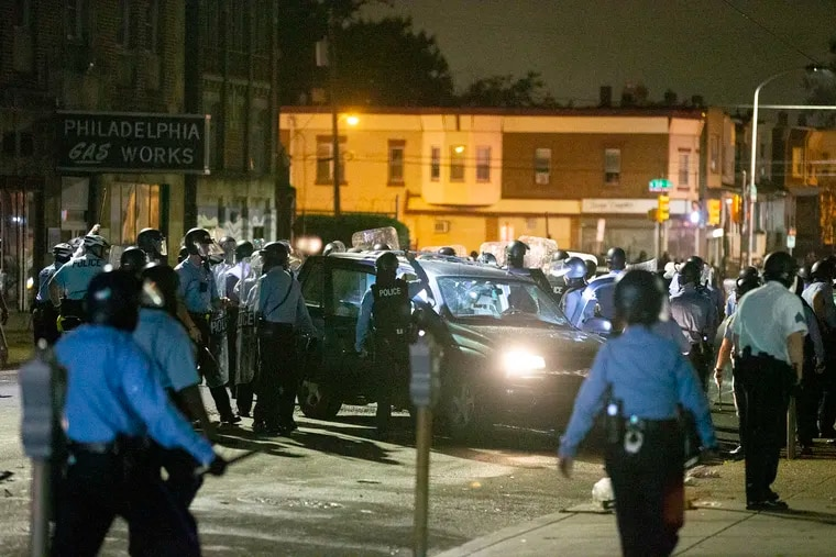 Philadelphia police officers on Oct. 27, 2020, bashed the windows of Rickia Young's SUV, pulled her out of the vehicle, beat her, then separated her from her toddler. The city this week announced it will pay her $2 million.