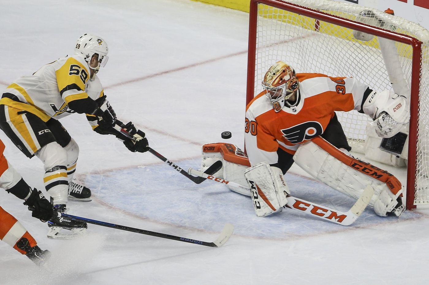 Flyers' Michal Neuvirth injured again; Cal Pickard gets rare start