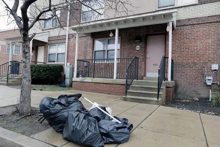 Keonna Thomas' home on North 10th Street, its flags waving. (ELIZABETH ROBERTSON / Staff Photographer)