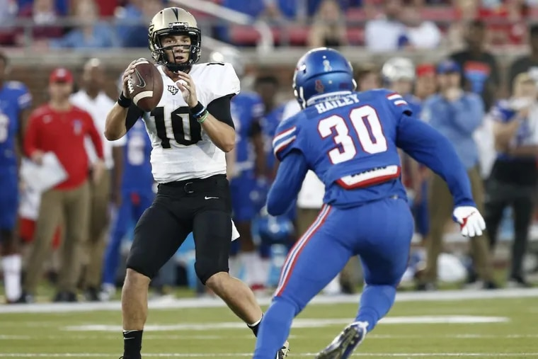 Central Florida quarterback McKenzie Milton (10) drops back to pass as SMU linebacker Shaine Hailey (30) defends during the first half Saturday.