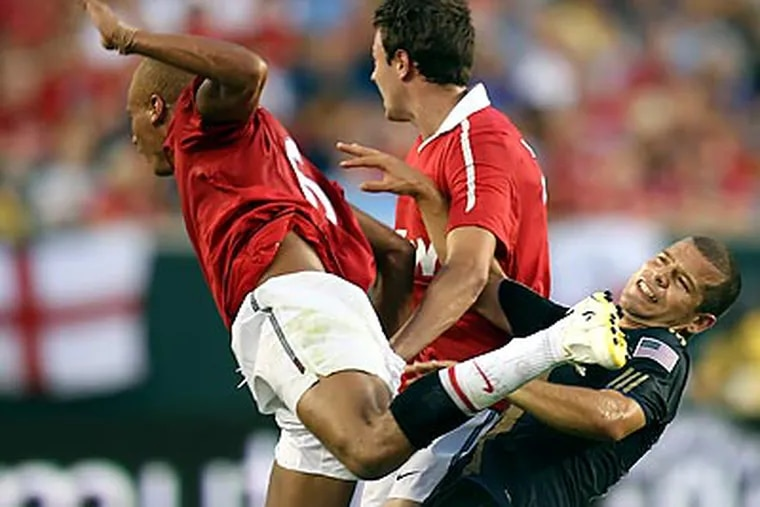 Alejandro Moreno is kicked by Manchester United's Web Brown during the first half. (Steven M. Falk / Staff Photographer)