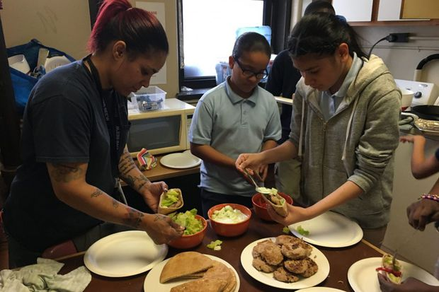 As class draws to a close, showing off their new cooking skills