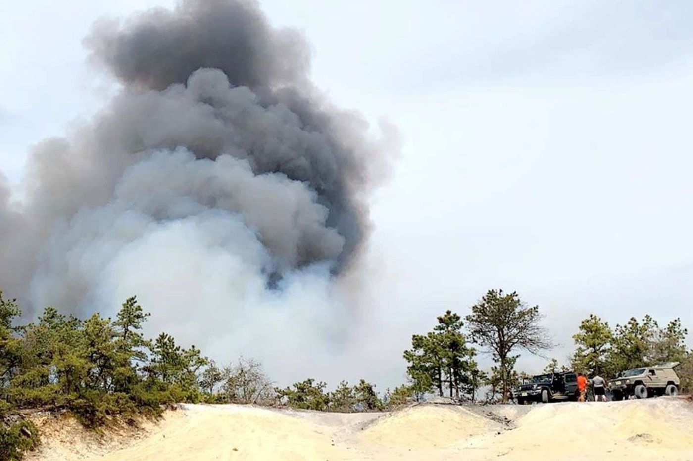 Police want to talk to men pictured next to trucks during big Pinelands fire