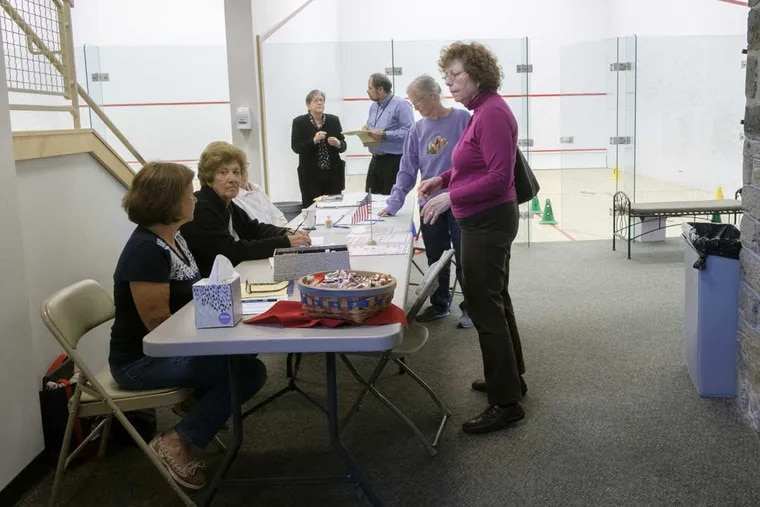 Linda Salford checks in at the Penn Charter squash courts, her polling place, on May 16, 2017.