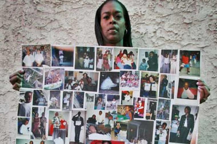 Marie Clarke with a photo collage recalling her slain son, Antonio.  (Alejandro A. Alvarez / Staff Photographer)