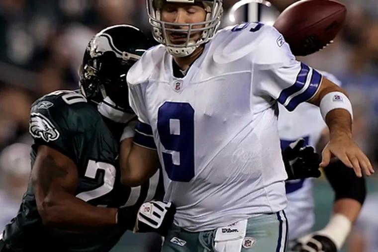 Brian Dawkins strips Dallas' Tony Romo of ball in third quarter.