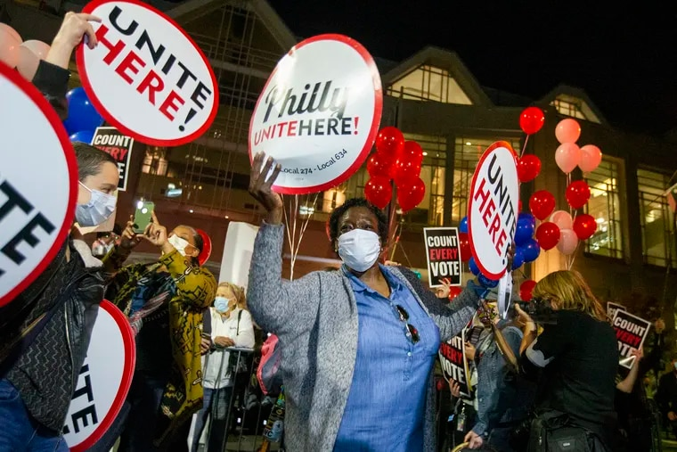 """Renee Wilson, a laid-off hotel worker from Philadelphia, dances with other Biden supporters at a """"Count Every Vote"""" counterprotest at the Pennsylvania Convention Center. She embodied the stakes many Black women felt about the election."""