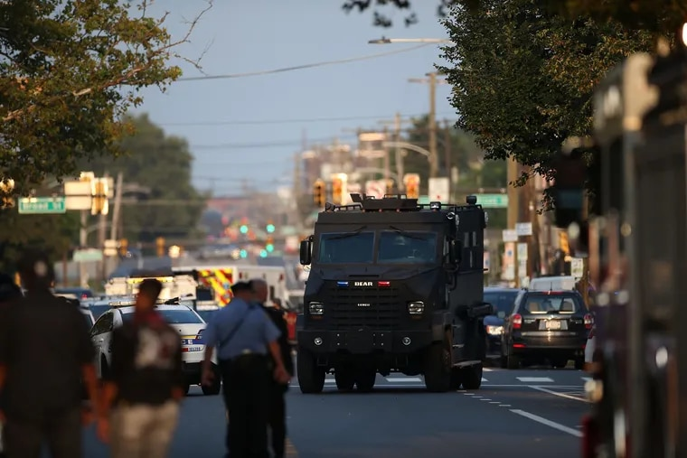 Law enforcement officers respond to a shooting on Wednesday, Aug. 14, 2019, in Philadelphia. At least six police officers were wounded in an hours-long standoff with a gunman that prompted a massive law enforcement response in the city's Nicetown-Tioga neighborhood.