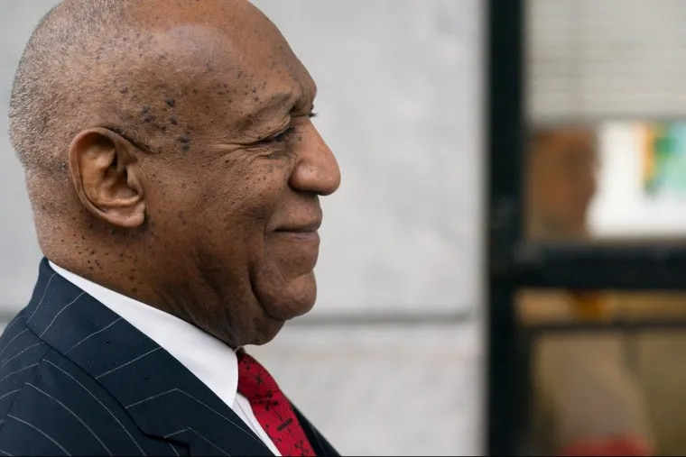 Bill Cosby receives assistance with his suit coat before walking into the Montgomery County Courthouse in Norristown on March 29, 2018.