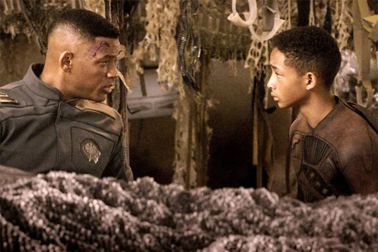 """Will Smith with son Jaden Smith in the sci-fi yarn """"After Earth."""" (Columbia Pictures)"""