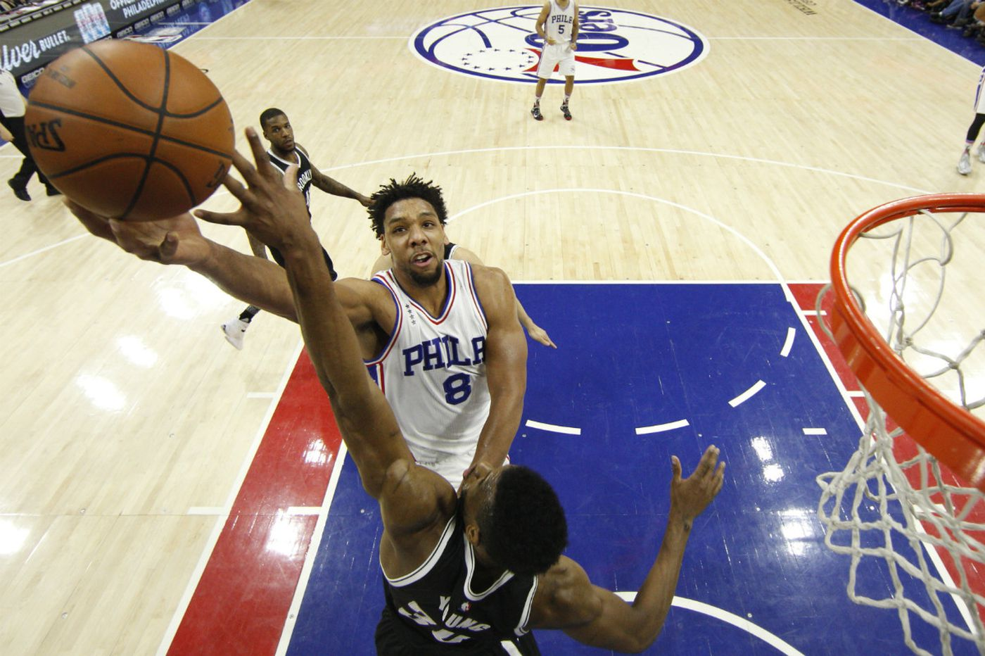 Sixers close strong to defeat Nets