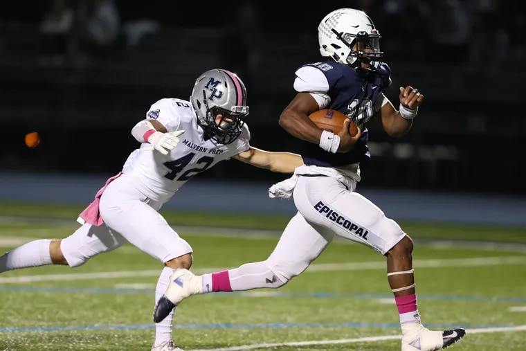 Marcus McDaniel of Episcopal Academy (with football), races for yardage with Malvern Prep's Cade Szostek in pursuit. McDaniel, a run-pass threat as a quarterback and standout defensive back, was selected to The Inquirer's All-Southeastern Pennsylvania football team.