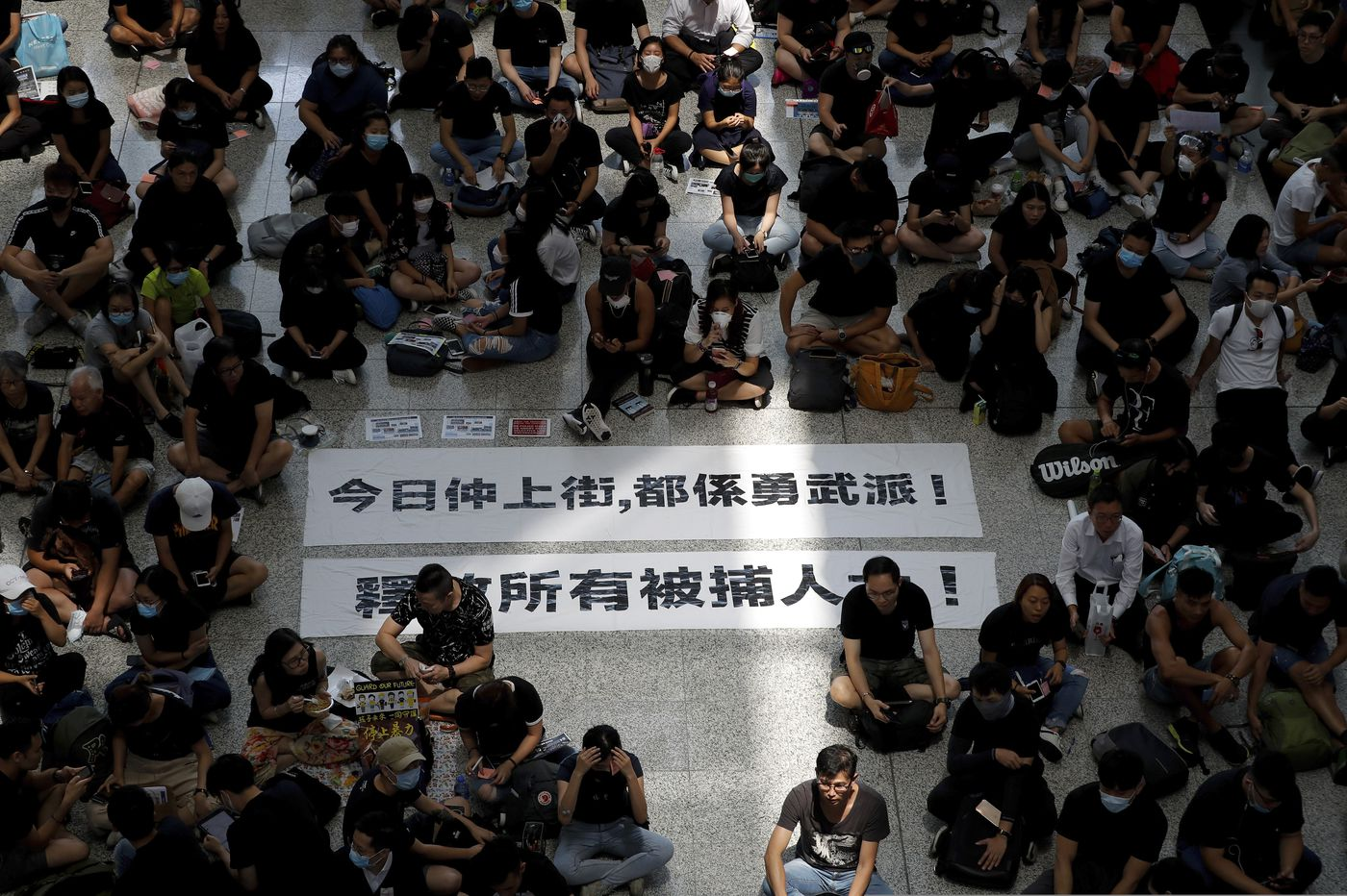 Hong Kong airport struggles to reopen after protests