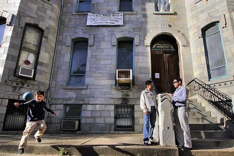 Gilberto Gonzalez (far right) and Miguel Ortiz (middle) talk while 8 yr old Lucas Teo Gonzalez (son of Gilberto) chases a handball in front of La Milagrosa Chapel, 1903 Spring Garden St. in Phila. on April 17, 2013.  ( ELIZABETH ROBERTSON / Staff Photographer )
