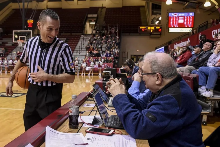 Referee Joe Vasily talks with Mel Greenberg during a timeout at a Dec. 11 women's basketball game between Penn and St. Joseph's.