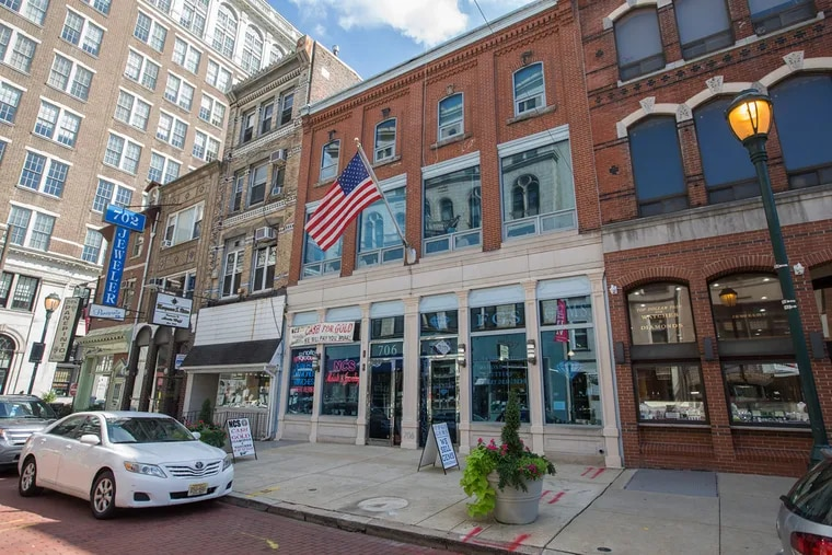 The condo tower proposed by Toll Bros. City Living would displace five properties in the 700 block of Sansom Street.
