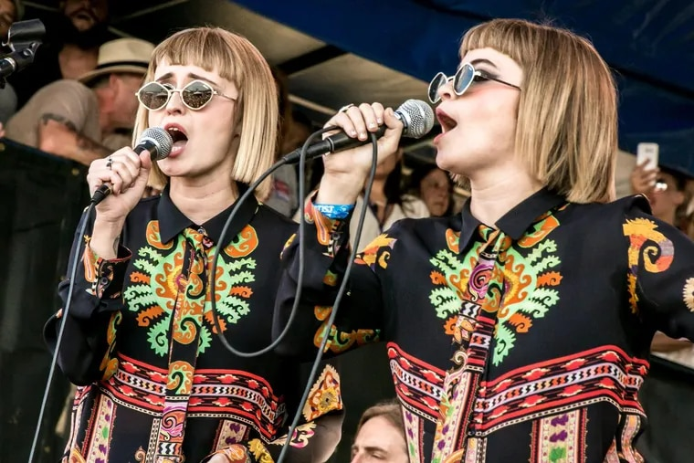 Jess Wolfe and Holly Laessig of Lucius at the Newport Folk Festival last month. They will perform with Roger Waters on his Us & Them Tour at the Wells Fargo Center in South Philadelphia this week.
