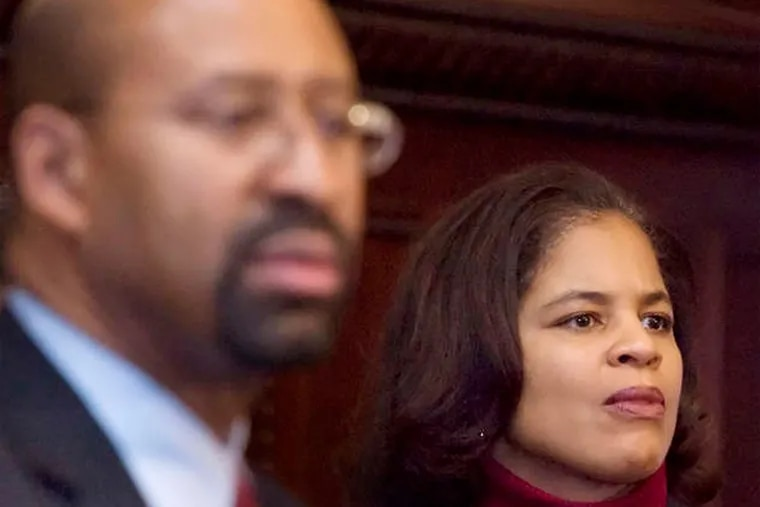 Mayor Nutter with City Solicitor Shelley R. Smith, who has decided that legal memos explaining city settlement payments  are not public information.