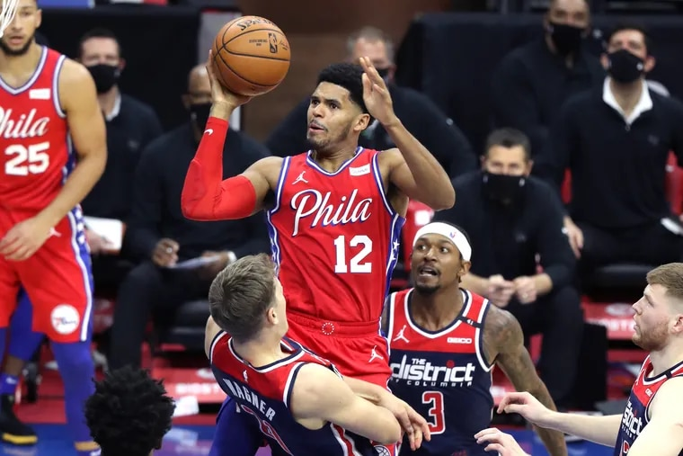 Tobias Harris, center, of the SIxers is called for an offensive foul as he collides with Moritz Wagner, left, of the Wizards during the 1st half of a NBA game at the Wells Fargo Center on Dec. 23, 2020.  Bradley Beal is 2nd from right.