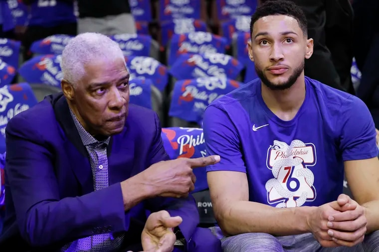 Sixers guard Ben Simmons listening to former Sixer Julius Erving (left) before a playoff game in May.