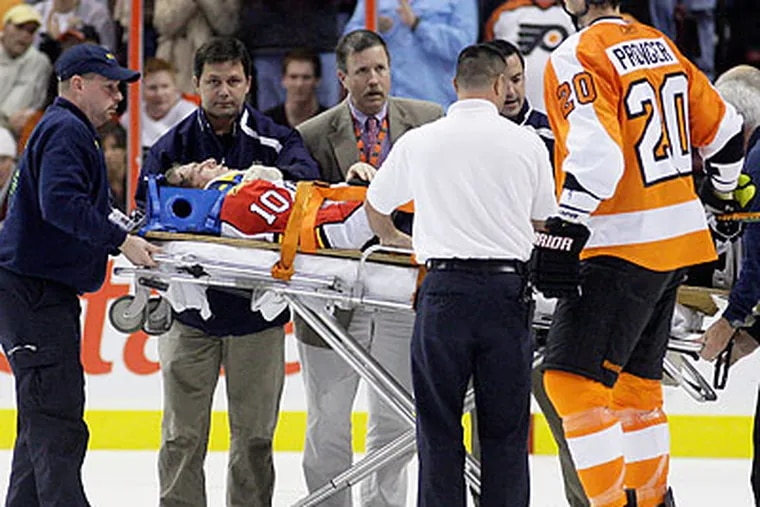 The NHL's hockey operations department reviewed Mike Richards' hit on Florida's David Booth - which resulted in a 5-minute major and game misconduct - and decided not to suspend or fine Richards. (Matt Slocum/AP_)