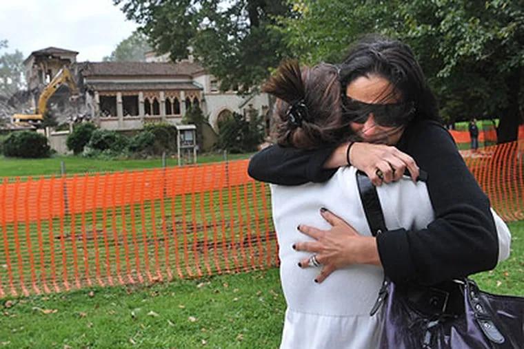 Liz Kania and Linda Kania Graupner (left) hug as the mansion La Ronda in Lower Merion is demolished. Linda grew up in La Ronda and Liz is her sister-in-law. (Sharon Gekoski-Kimmel / Staff Photographer)