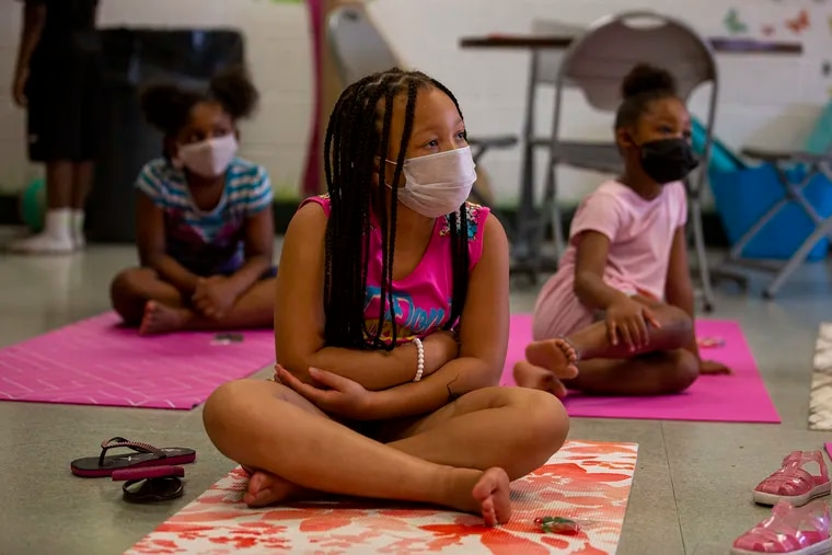 Sasha Richardson, 8, sits wearing a mask in summer camp at Martin Luther King Jr. Recreation Center in Philadelphia last summer. Philadelphia just tweaked their vaccination requirements to give more leeway to kids under 12.