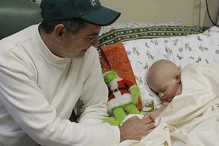 """""""How do you define 'winning?' """" asks Paul Van Nocker, shown here with his 3-year-old son, Kyler. The youngster has undergone  a 10-hour operation to remove the remains of a metastasized tumor that has threatened his life for much of the last year."""