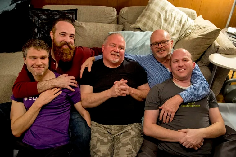 Men's Therapeutic Cuddling is a meet-up group that aims to give men a safe space to ask for help or affection. During a demonstration held for The Inquirer, members (from left) Kyle Hoffman, Scott Turner, TJ McDonnell, Kevin Eitzenberger, and Ryan Hancock pose together.