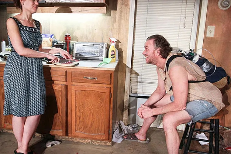 """Kitchen drama: Catharine Slusar and Pearce Bunting in Theatre Exile's production of Sharr White's """"Annapurna."""" (Paola Nogueras)"""