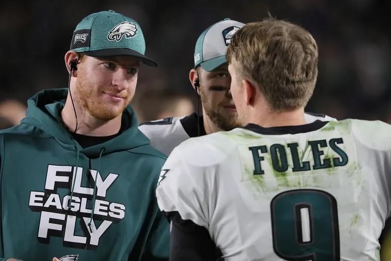 Eagles quarterbacks Carson Wentz (left) and Nick Foles.
