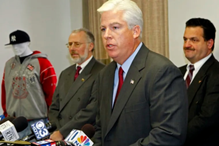 Pressing the hunt for the killer are (from left) Rowan University president Donald J. Farish, Prosecutor Sean F. Dalton, and Thomas Sullivan, chief of county detectives. The mannequin was wearing clothing similar to that of a man sought in the October murder of Donald Farrell.