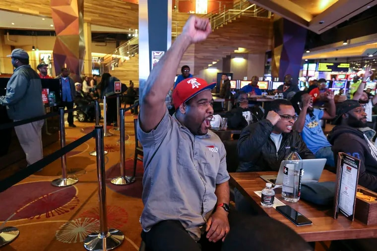 Abel Robinson (left) and Jay Kirkland visited SugarHouse Casino on Thursday night to bet on the Sixers' game against the Raptors. (If they picked the home team, it paid off.) Tuesday marks the one-year anniversary of the legalization of sports betting.