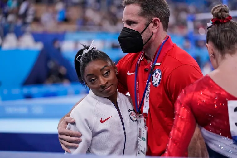 Simone Biles, left, will compete in the balance beam finals on Tuesday, a little over a week after stepping away from the meet to focus on her mental health.