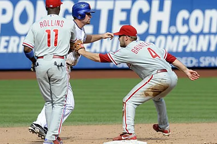 Among Eric Bruntlett's highlights as a Phillie was this unassisted triple play against the Mets in August. (Henny Ray Abrams/AP)