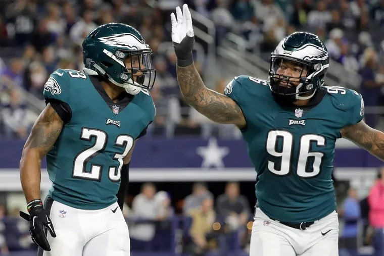 Eagles rookie Derek Barnett, right, celebratiing with Rodney McLeod after McLeod scored on an interception against the Cowboys in the teams' first meeting last month.