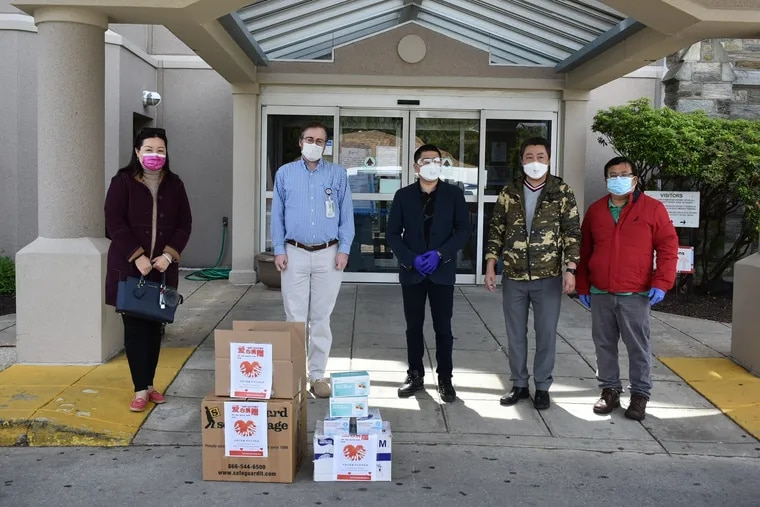 At the Inglis House in Philadelphia on Tuesday May 5, members of the local Chinese American United Association deliver supplies of protective equipment to help people avoid the coronavirus. From left to right, they are: Holly Meng, Inglis executive Christopher Bathe, Jason Lam, Duanjin Lu, and Jinguang Wu.