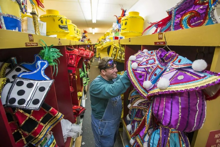 The Avalon  String Band will have a toy-filled theme. Ken White works among the  lockers of costumes.