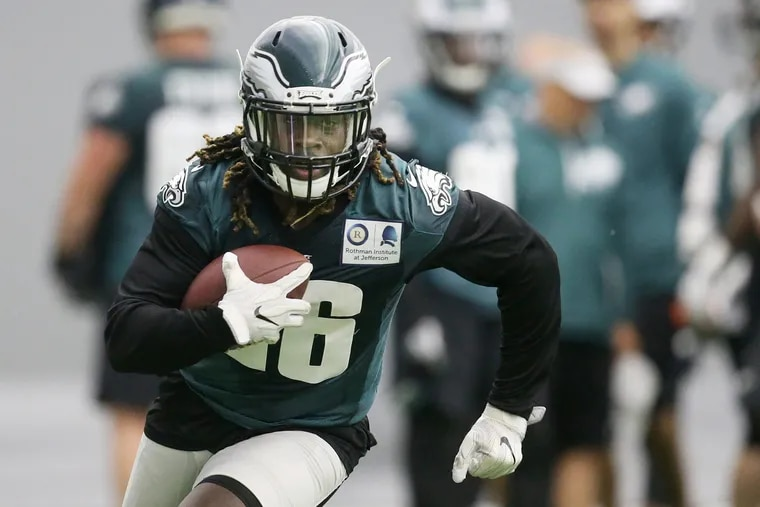 Eagles running back Jay Ajayi carries the ball during practice at the NovaCare Complex in South Philadelphia on Tuesday, May 22, 2018. Tuesday was the first day of the Eagles' organized team activities. TIM TAI / Staff Photographer