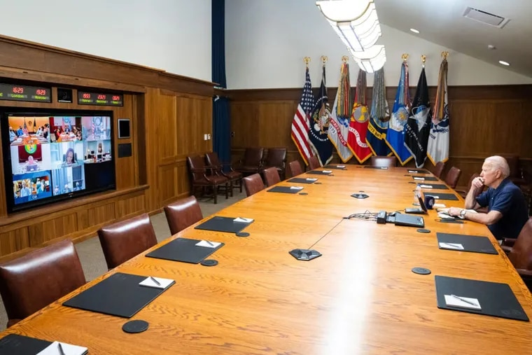 In this White House handout, U.S. President Joe Biden and Vice President Kamala Harris (on screen) hold a video conference with the national security team to discuss the situation in Afghanistan on Monday.