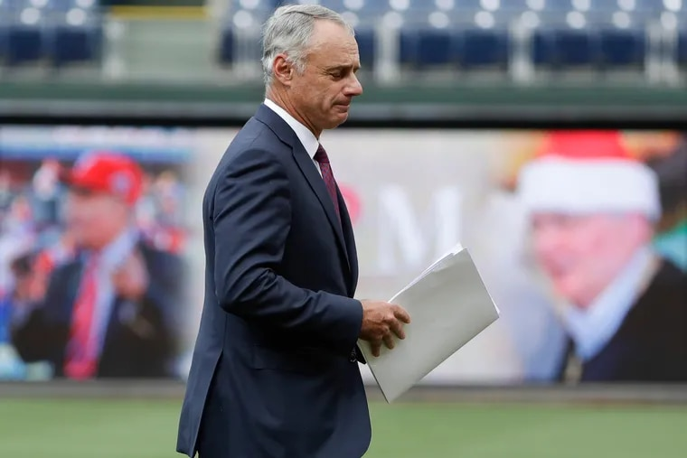 Major League Baseball Commissioner Rob Manfred walks off the stage after making remarks during the celebration of life for Phillies Chairman David P. Montgomery at Citizens Bank Park on Thursday, June 6, 2019.  Montgomery was one of the most respected and admired executives in baseball.