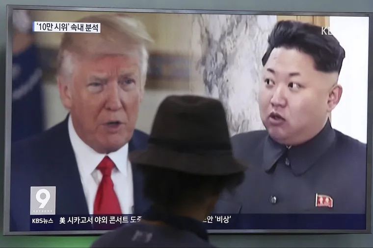 At the Seoul train station in August, a passerby watches a split-screen news program shot of President Trump and North Korean leader Kim Jong Un.