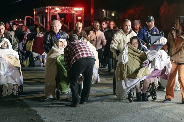 4-alarm blaze at the Barclay Friends Nursing Home in West Chester, residents many in wheelchairs evacuated from the building, Thursday, November 16, 2017. STEVEN M. FALK / Staff Photographer