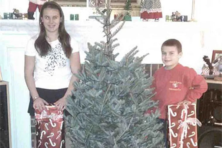 Marissa Cupaiuolo and her brother, Anthony, with gifts donated after fire destroyed their East Goshen Township home. (Family photo provided by Angela Cupaiuolo)