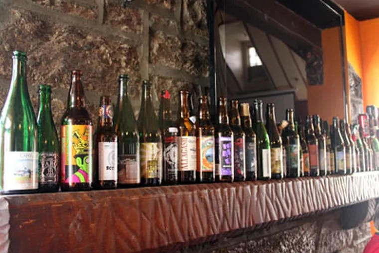 The Wet Whistle Bar mantle holds a distinguished row of empties. (Photo / Stephen Lyford)
